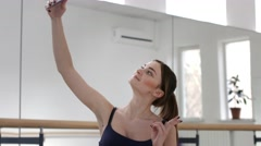 Girl chatting online and make selfie in dancing room Stock Footage