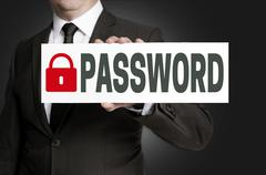 Password placard is held by businessman Stock Photos