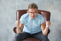 Portrait of a stylish intelligent man stares into the camera, small unshaven, - stock photo