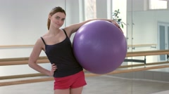 Young woman with fitness ball Arkistovideo