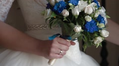 Bride holding wedding bouquet in hands - stock footage