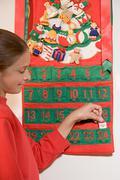 Girl with an advent calendar Stock Photos