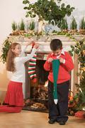Children with christmas stockings Stock Photos