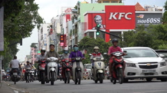 Vietnam, Asia, branch of Kentucky Fried chicken, rush hour traffic, contrast - stock footage