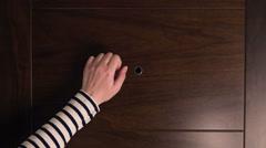 Female hand knocking at wooden door, visitor or guest at the door Stock Footage