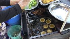 Peparing Banh khot mini savory coconut pancake Stock Footage