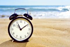 adjusting forward the clock for the summer time - stock photo