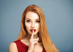 Hush. Sexy Woman with Finger on her Lips. Stock Photos