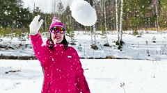 Snowball Fight by a Young Beautiful Woman in Snow in Slow Motion Arkistovideo