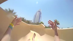 Riding a crazy fun waterslide point of view GoPro footage in Dubai water park Stock Footage