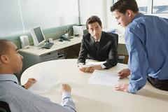 Businessmen discussing document Stock Photos