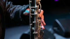 musician playing bassoon, wind instrument, slider shot - stock footage