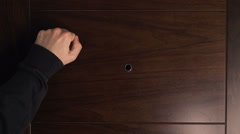 Stock Video Footage of Male hand knocking at wooden door, visitor or guest at the door