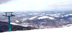 Retro Ski Lift Moving up to the Mountain. Stock Footage