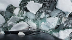 Bow of Icebreaker Ship breaks ice. Top view. Stock Footage
