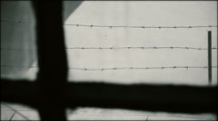 Jail window with barbed wire Stock Footage
