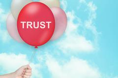 Hand Holding trust Balloon Stock Photos