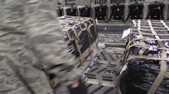 BAGRAM AFGHANISTAN, JANUARY 2016, Close Up US Soldiers Push Supply In Aircraft Stock Footage