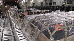 BAGRAM AFGHANISTAN, JANUARY 2016, Full Shot US Soldiers Push Supply In Aircraft Stock Footage