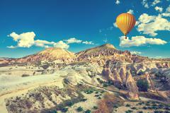 Hot air balloon over Cappadocia - stock photo