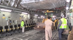 BAGRAM AFGHANISTAN, JANUARY 2016, Digger Drive Backwards In Cargo Area Aircraft - stock footage