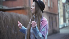 Pretty girl dancing on the alley and enjoying it, steadycam shot - stock footage