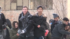 Students snowball fight on campus Arkistovideo