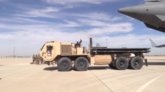 BAGRAM AFGHANISTAN, JANUARY 2016, US Military Truck Drives Away Aircraft - stock footage