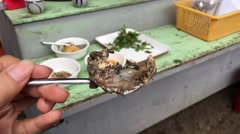 Part from the Balut (fertilized duck egg) on a spoon Stock Footage