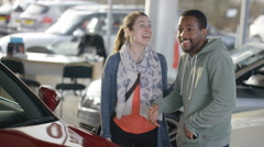 4K Happy couple buying new car ask salesman to take their picture Stock Footage