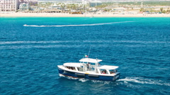 Tender Boat Along the Shores of Cabo San Lucas Mexico Stock Footage