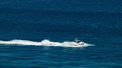 Man Riding Jet Ski on Blue Ocean Water Stock Footage