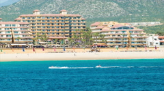 Beachfront Hotel in Cabo San Lucas with Passing Jet Skis Stock Footage