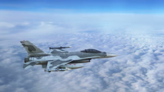Fighter jet in flight, military aircraft flying above clouds Stock Footage
