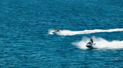Guys Riding Jet Skis on Blue Ocean Water Stock Footage