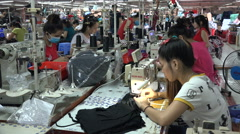 Busy factory floor, workers use sewing machines in Vietnam, Southeast Asia Stock Footage