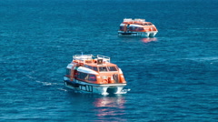 Cruise Ship Tender Boats on Blue Ocean Water Stock Footage