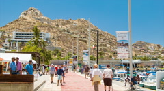 People Visiting Cabo San Lucas Mexico Walking Along The Marina Stock Footage