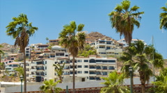 Luxury Mexican Apartment Buildings Against The Hills in Cabo San Lucas Stock Footage