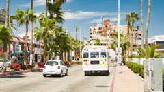 Cabo San Lucas Mexico Street Scene with Passing Vehicles Stock Footage
