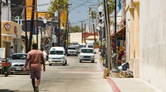 Cabo San Lucas Mexico Side Street Scene with Local Shops and Vehicles Stock Footage
