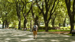Buenos Aires Argentina Man Walking in Plaza de Mayo Park Stock Footage