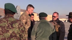 AFGHANISTAN, JANUARY 2016, Afghan Pilot Talks To Other Soldiers Stock Footage