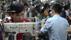 Asia employment sewing machine focus manual labor factory floor Vietnam Stock Footage
