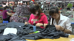 Women at work in a textile production factory, garment industry in Vietnam, Asia Stock Footage