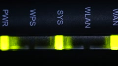 The flickering lights of the Internet equipment (Wi-Fi, Wireless router) on a da Stock Footage