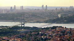 High angle of Istanbul City in Summer. Bosphorus Bridge during sunset Stock Footage
