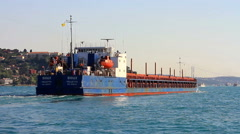 Tracking shot of a cargo ship sailing out at Bosporus straits - stock footage