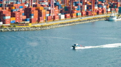 Boat Speeding Through Vancouver Harbour with Cargo Container Backdrop Stock Footage