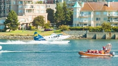Victoria BC Inner Harbour Action with Seaplane Landing Among Boats Stock Footage